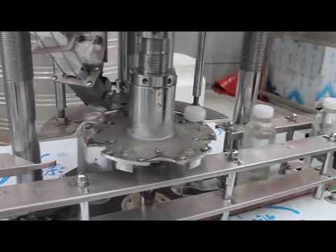 automatic single head plastic bottle rotary capping machine